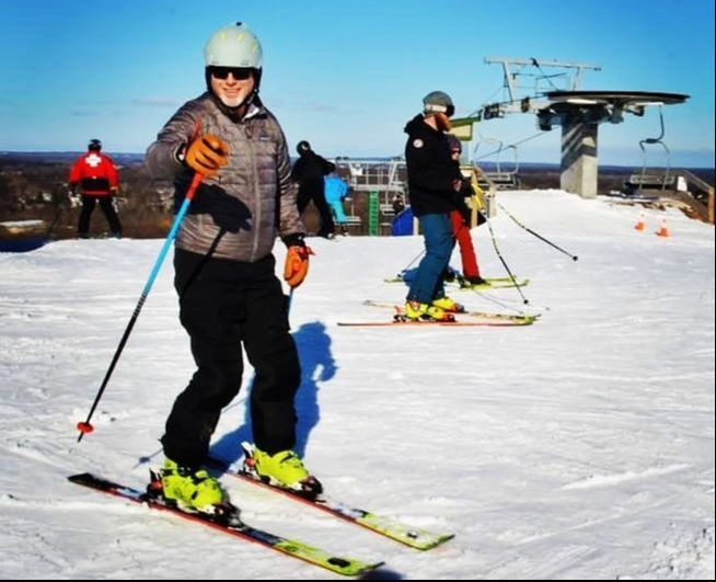 Picture of Pat, the smiling face that many guests will see at the Pine Knob Ski School desk.