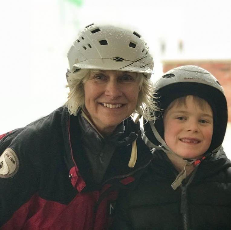 Picture of Pine Knob ski instructor Monica with her young student. They are bundled up in their winter gear and smiling at the camera.